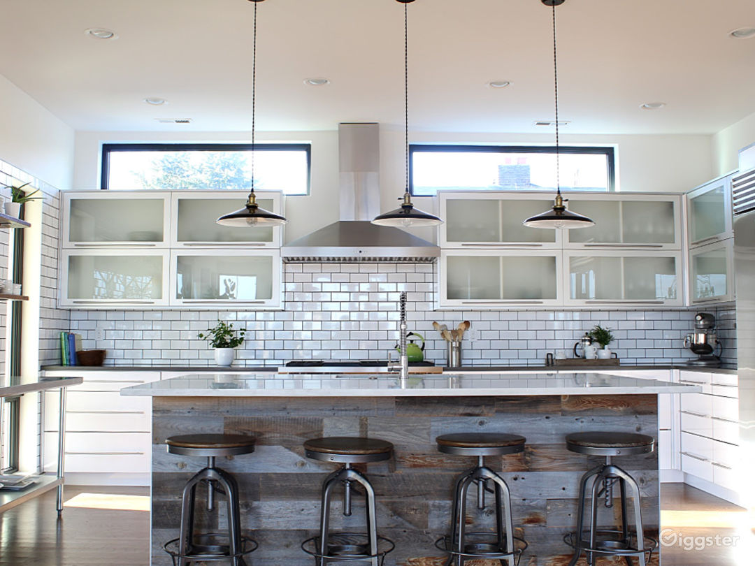 Modern, open kitchen, marble island, plenty of bright light and room for a crowd