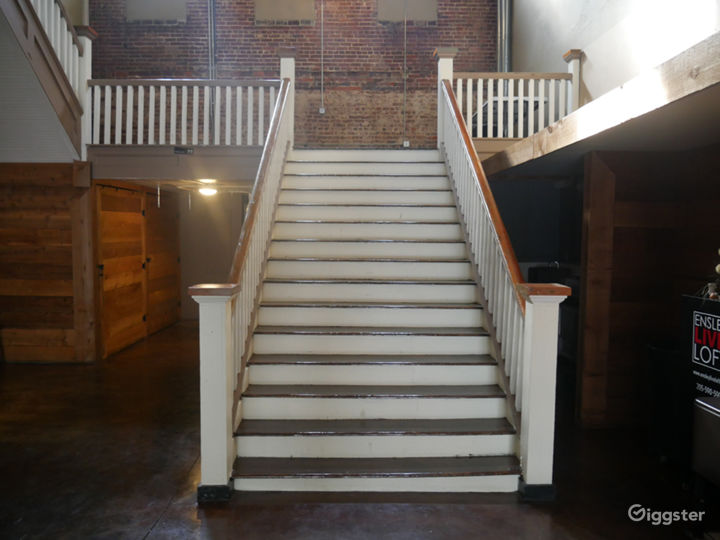 Live Loft dramatic southern charm staircase with exposed brick walls