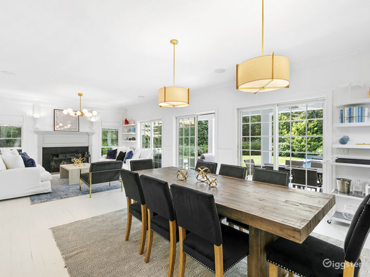 Open living and dining area which also has counter seating facing the kitchen