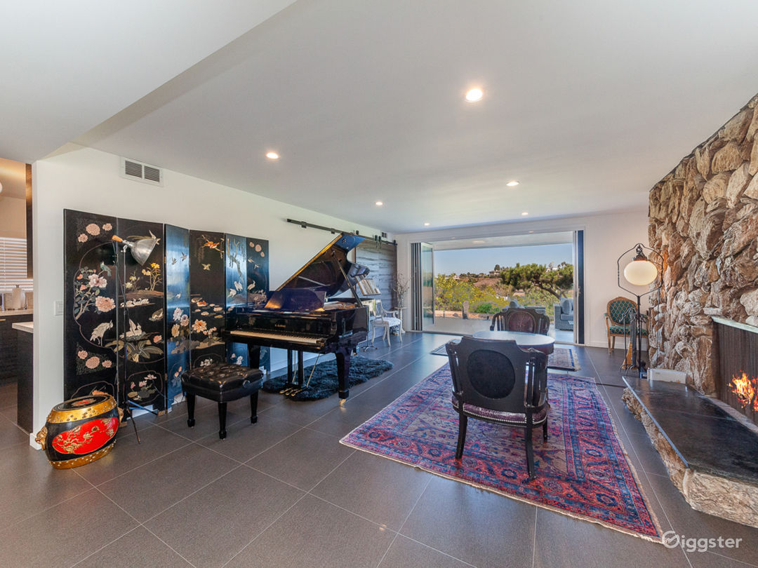 Living room features Kawai grand piano and fireplace.