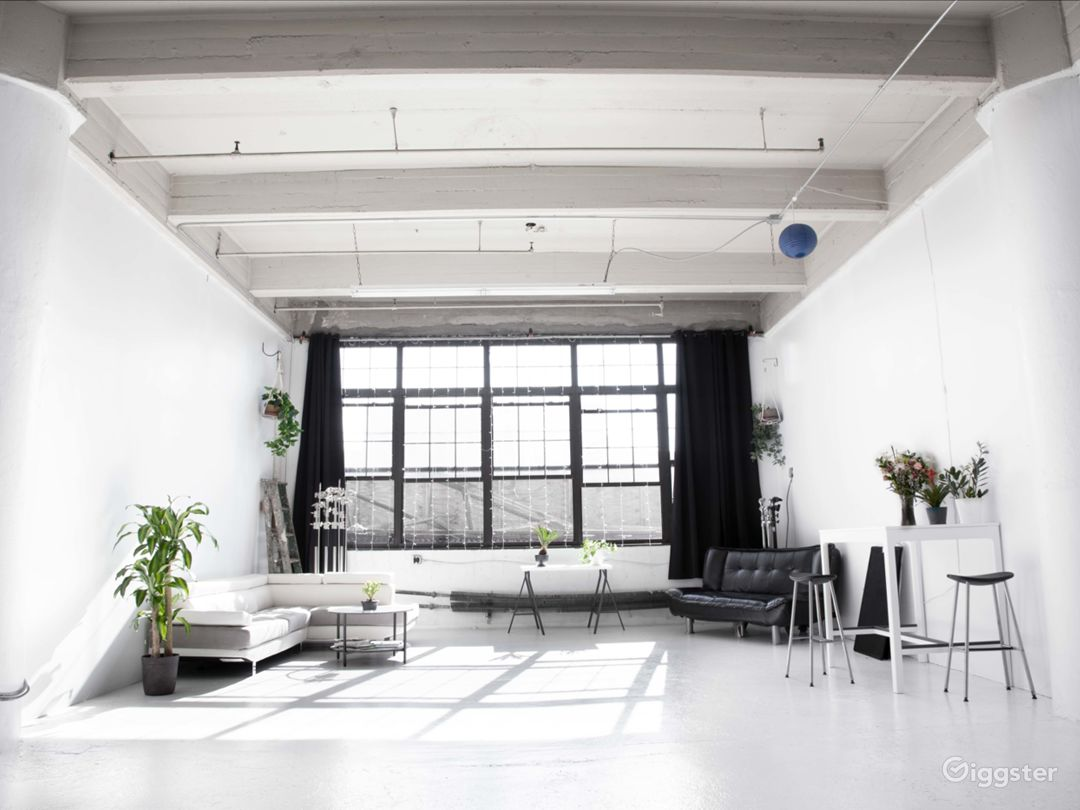 Glowing All-White Loft with Wall of Windows Photo 2