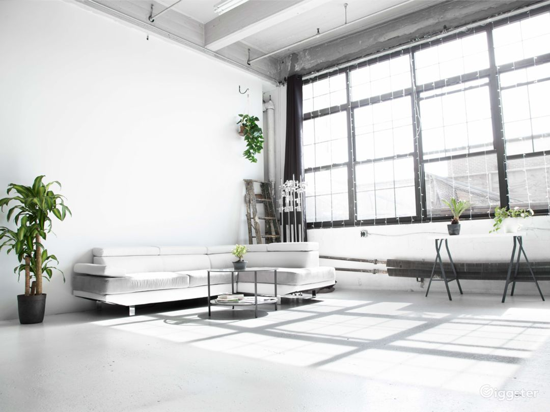 Glowing All-White Loft with Wall of Windows Photo 1