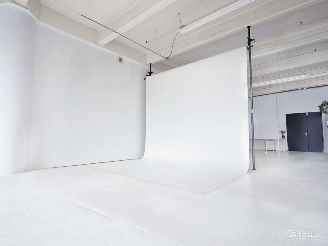 Glowing All-White Loft with Wall of Windows Photo 3