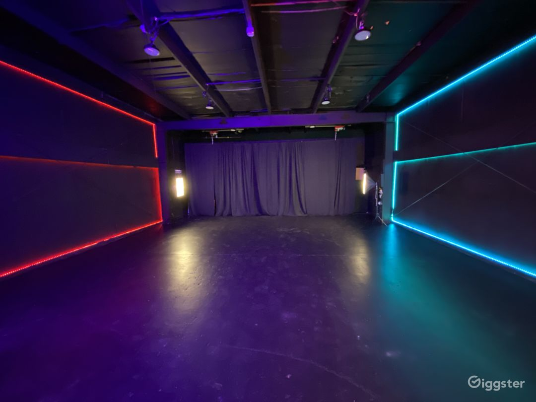 Large performance, pre production area. 30x30 black box with motorized pipe and drape in the rear. Exposed steel beams allow the use of beam clamps to bring any idea to life.  -Set the mood with led accent walls that can be changed to any color