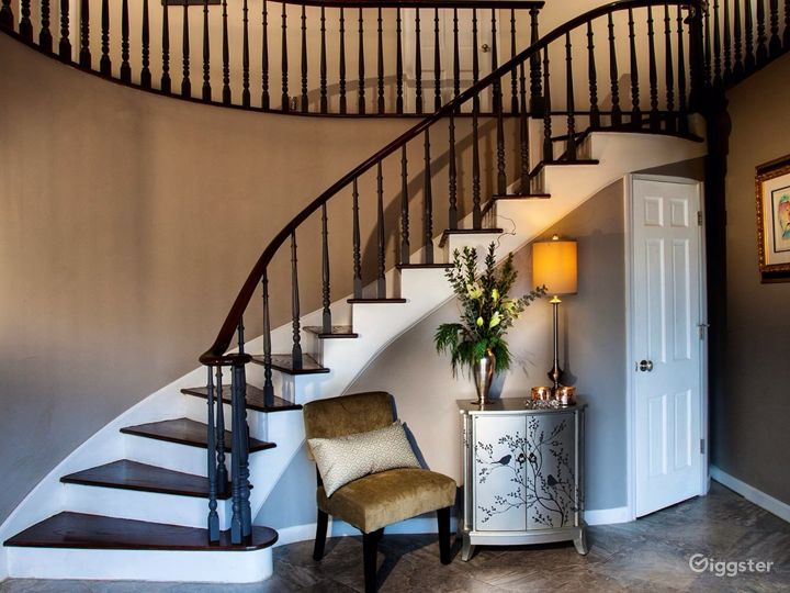 Elegant entry with sweeping staircase