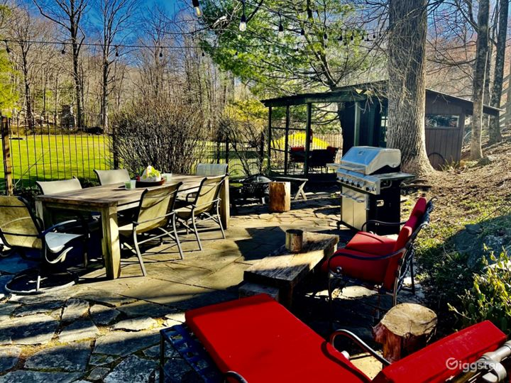 Gated garden and outdoor living room, featuring teak table, propane BBQ, fire pit, potting shed with covered decking. Mature trees and landscaping, provide shade and amazing color as the season changes.