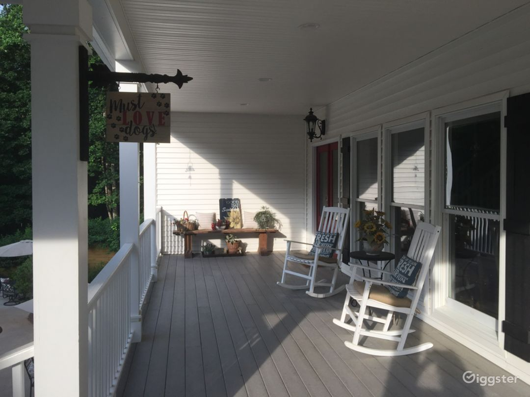 Front porch of house.....overlooks pool and is attached by breezeway to garage