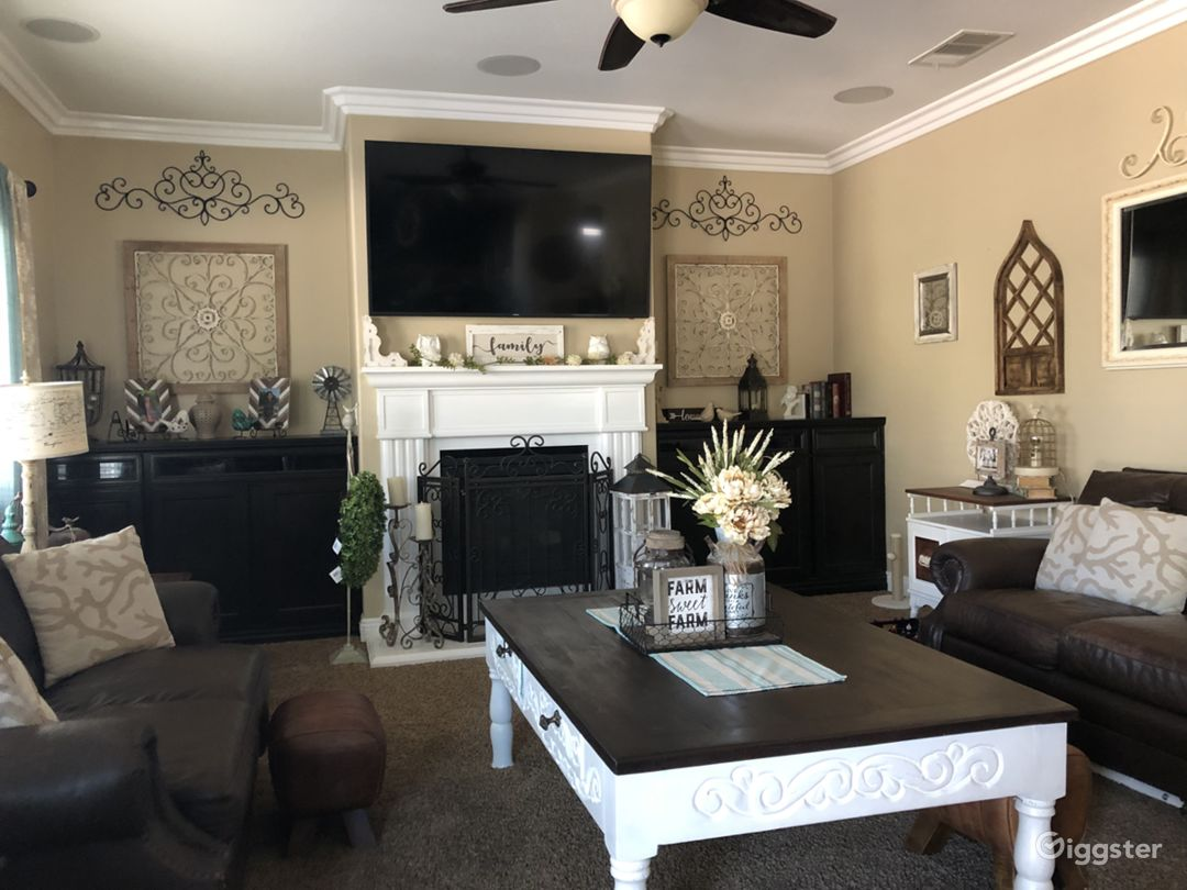 Large family room, rustic country style decor throughout. Many amenities and upgrades such as stainless steel appliances, wood floors, granite counter tops, and crown molding.
