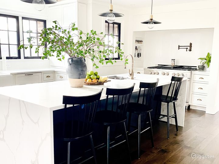 New custom kitchen in 2020.  Custom white cabinetry, quartz waterfall island and countertops.  Top of the line appliances with a custom range nook.