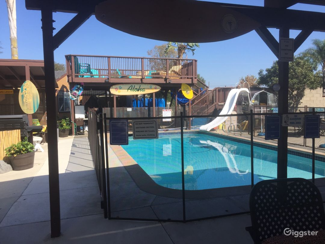 """Our huge backyard we call the """"Tiki Village"""" (water slide is no longer there)"""