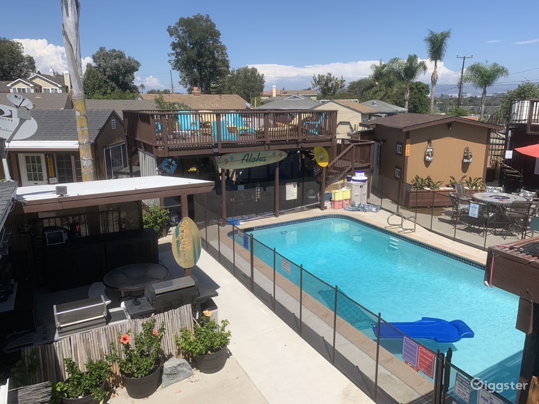 """Our """"Tiki Village"""" view of the pool, our outdoor kitchen, one of 2 Sundecks, several buildings available to film inside of!"""