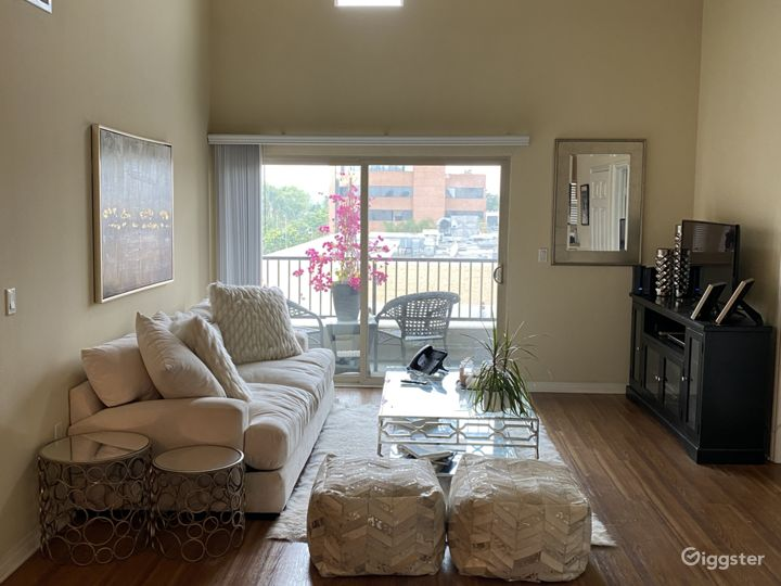 Living room with vaulted ceiling's,  great lighting  and charming balcony