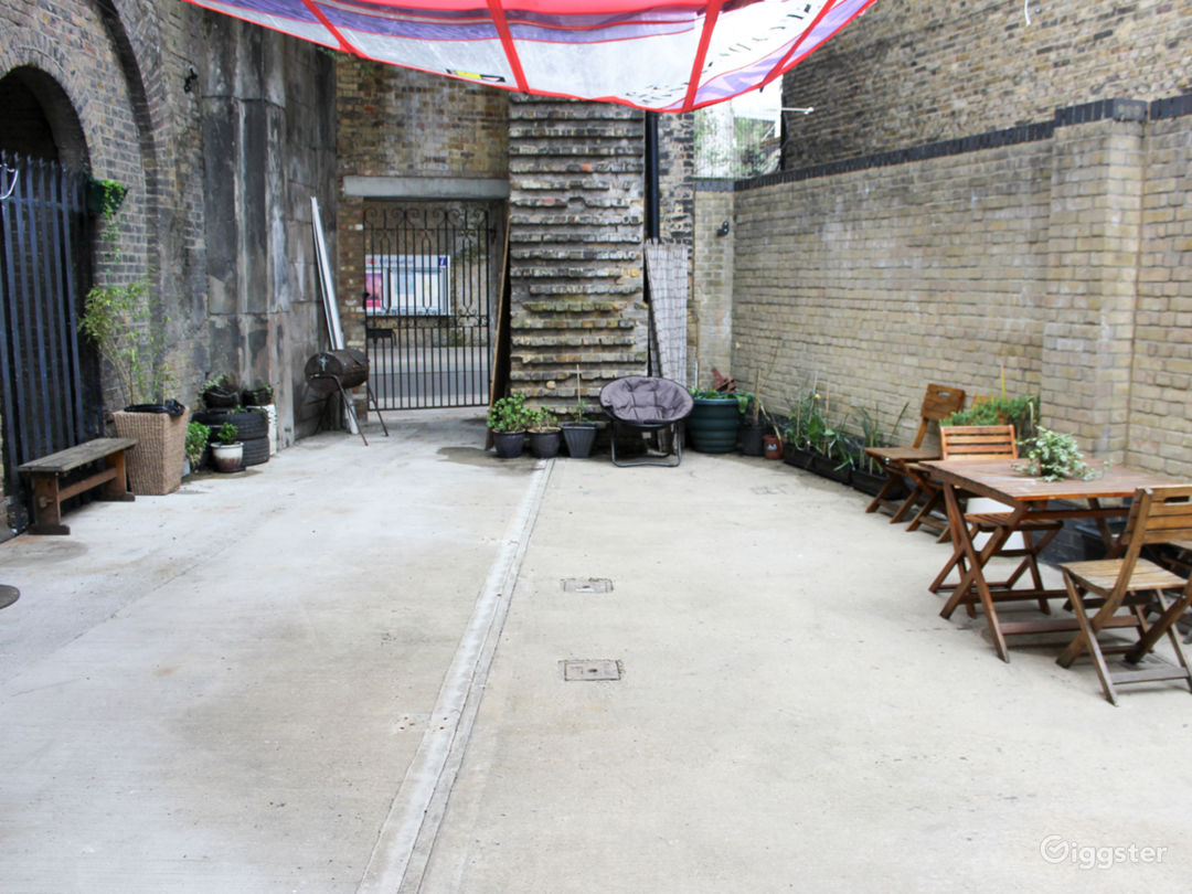 Courtyard Studio Garden With Chairs And Plants Photo 1