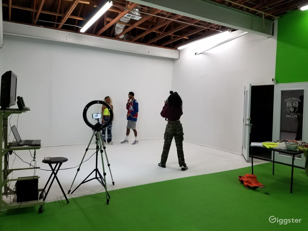 Standard Green and White Wall with an open ceilings to mount different type of lights and props.