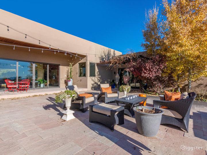 Outdoor patio/courtyard daylight.  Mature landscape, rose garden, patio.