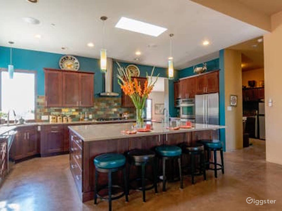 Kitchen with large granite top island
