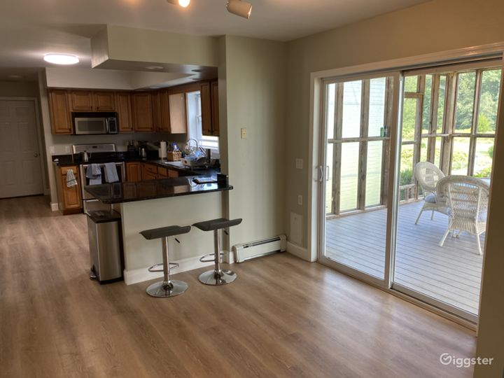 Kitchen area / breakfast nook and entrance to screened in porch