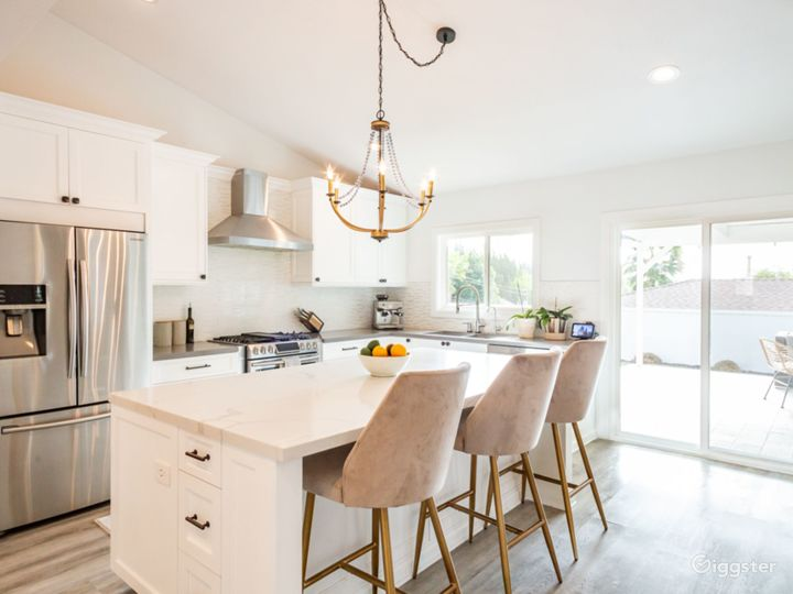 Samsung steel appliances with island and bar stools
