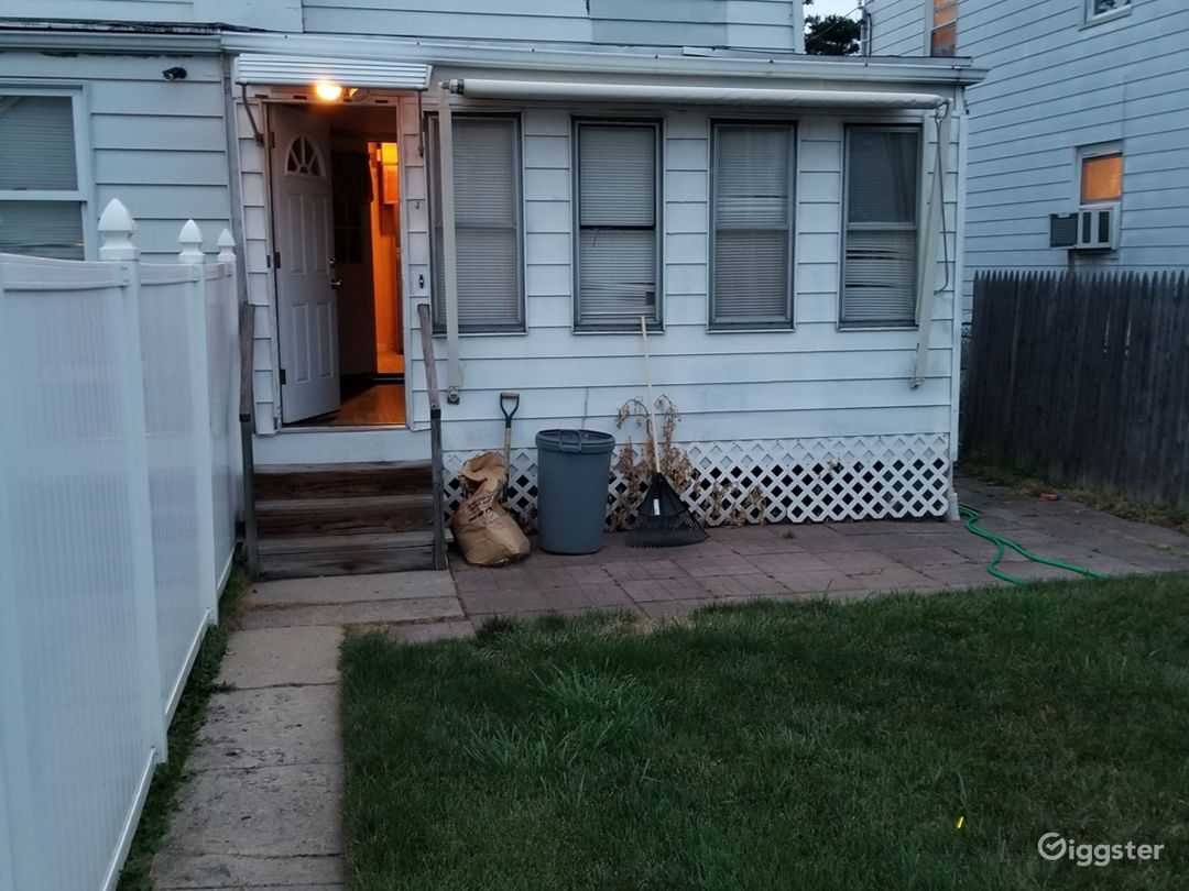 This is the back yard. Inside the first door is an indoor deck. I use it for the smoking area. There's another door directly after the first. The second door opens to the kitchen.