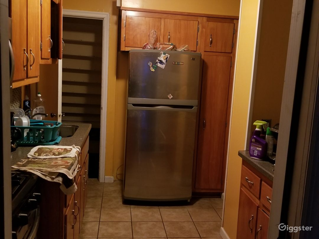 This is just after the second door of the rear entrance. Notice the door to the basement to the left of the refrigerator.