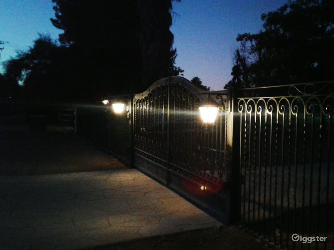 Classy gated entrance with long circular driveway