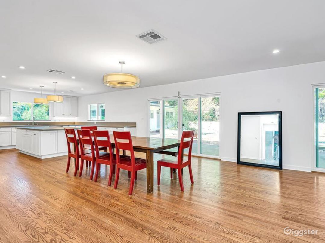 Open plan kitchen, dining, and living room. All furniture can be removed or can stay.