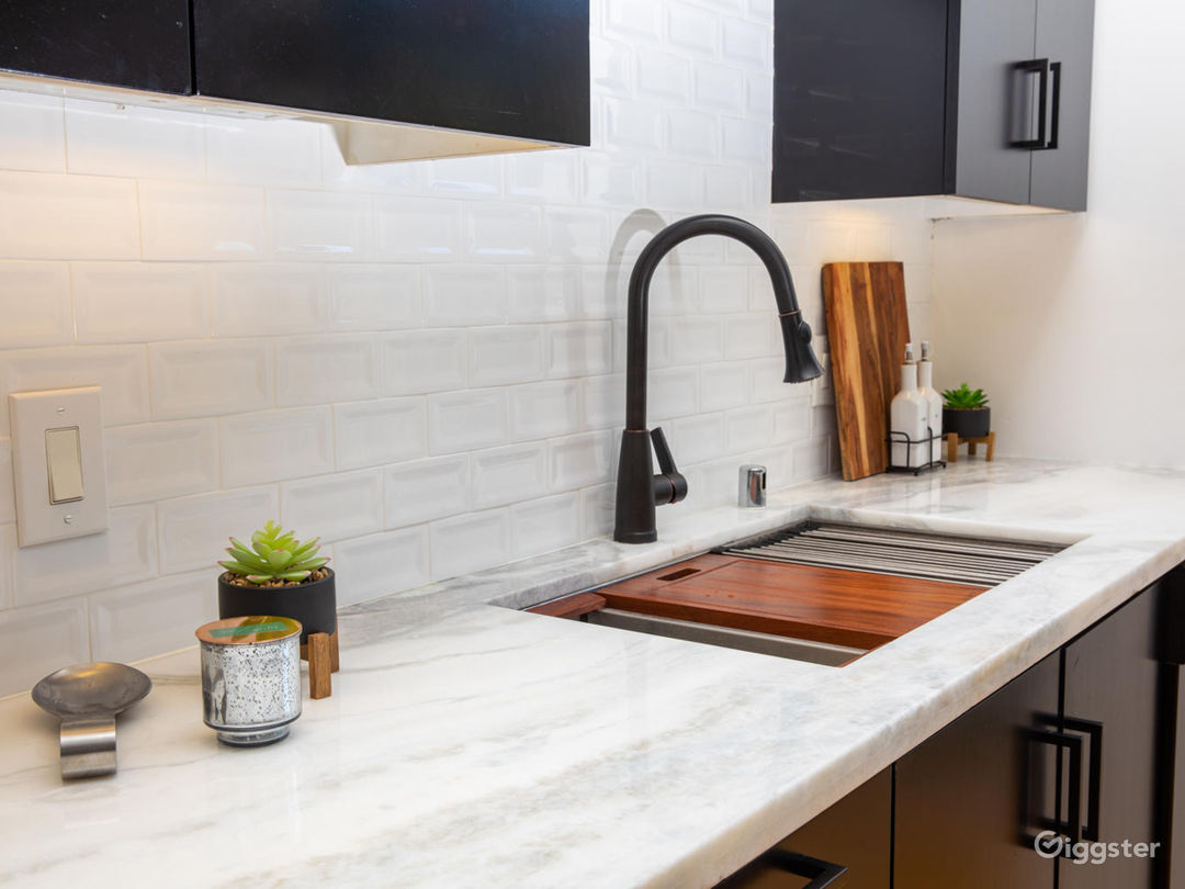 Marble Countertops and Porcelain Beveled Backsplash