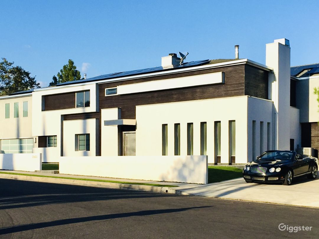 Exterior with room for 6 cars on 2 driveways + good street parking.