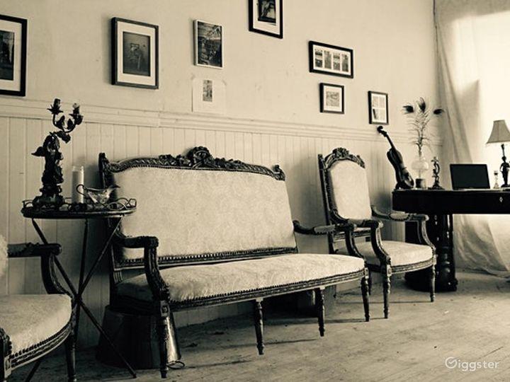 Local Artwork Adorned Indoor Space with Antique Furnishings - Speakeasy Photo 3