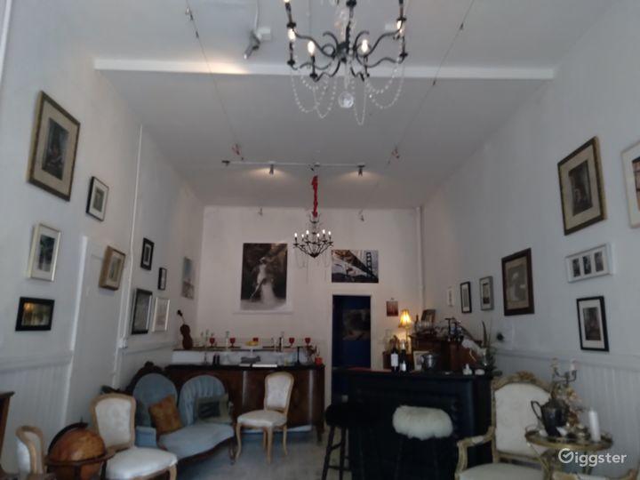 Local Artwork Adorned Indoor Space with Antique Furnishings - Speakeasy Photo 4