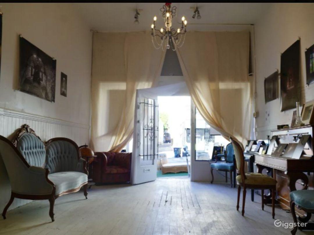 Local Artwork Adorned Indoor Space with Antique Furnishings - Speakeasy Photo 1