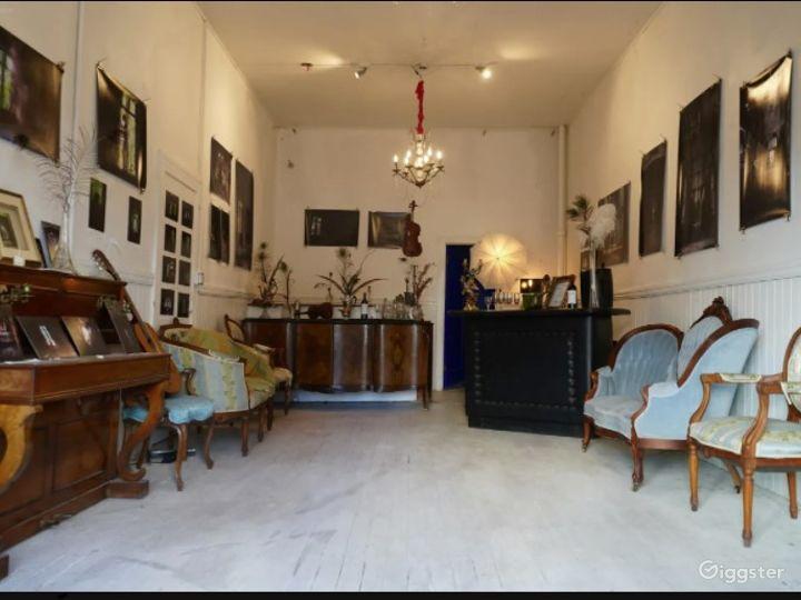 Local Artwork Adorned Indoor Space with Antique Furnishings - Speakeasy Photo 5