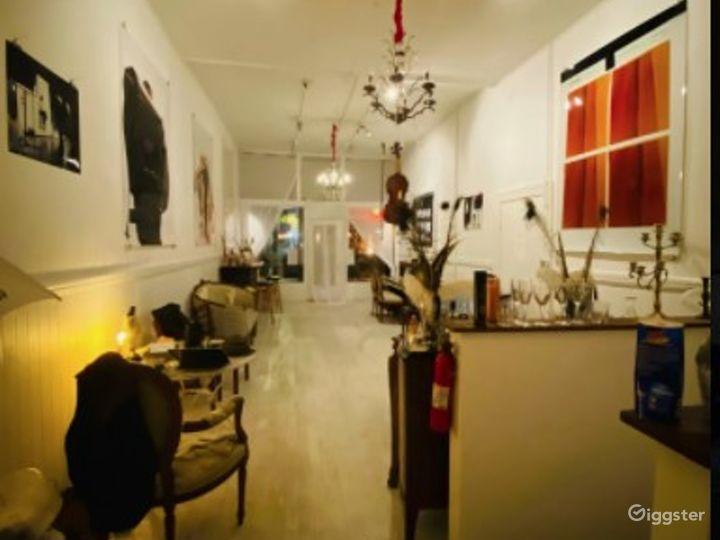 Local Artwork Adorned Indoor Space with Antique Furnishings - Speakeasy Photo 2