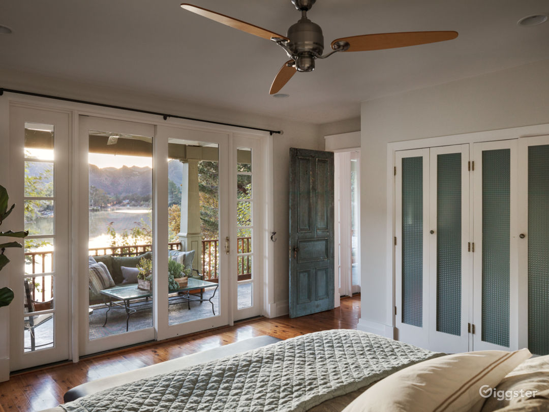 Master bedroom with lake view and large outdoor porch.