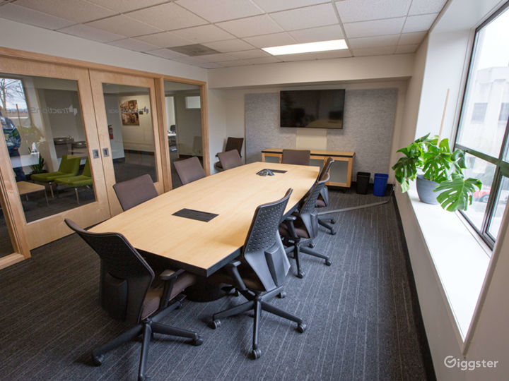 Our 'Board Room' caliber conference room suitable for formal meetings. Its large picture windows fill the space with light but the glass 'barn doors' give it an air of sophistication.  This is located on the second floor and is ADA accessible!