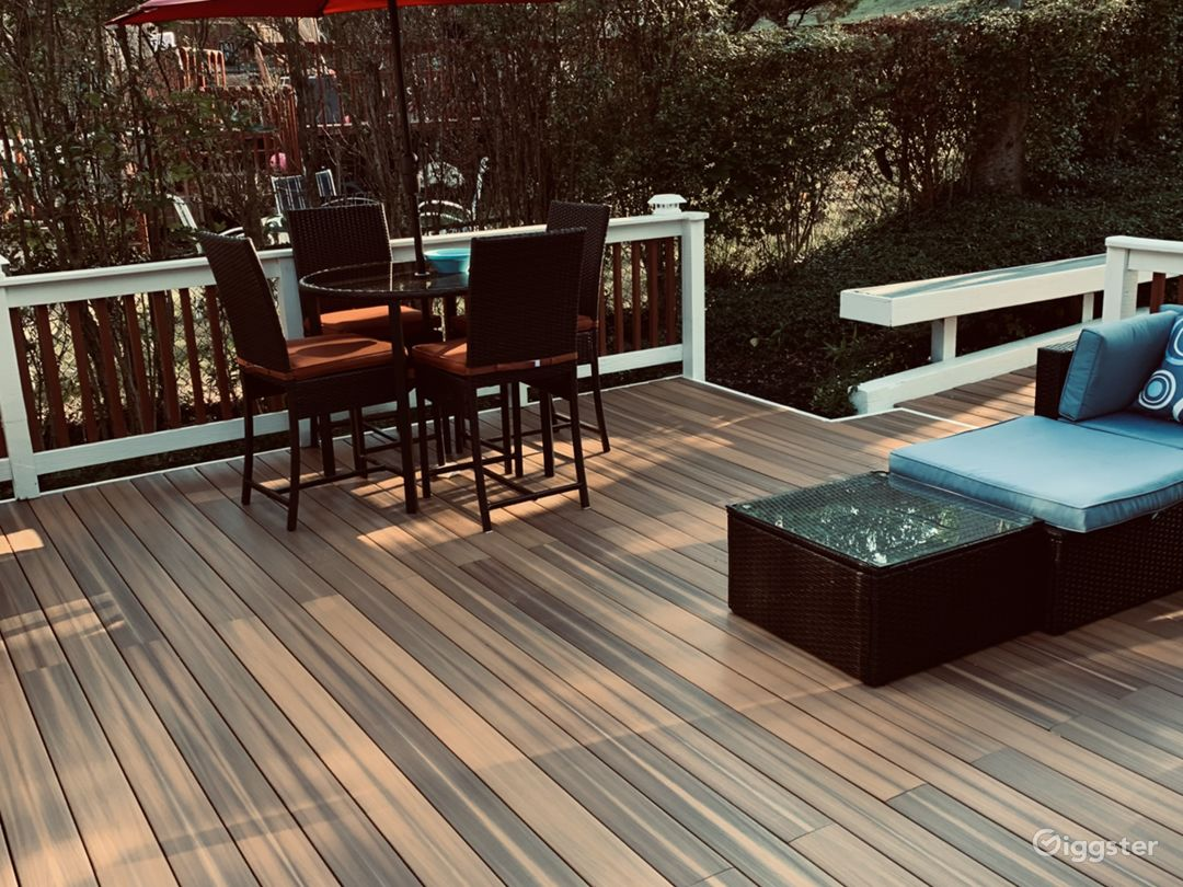 Rear deck with seating and fire pit.