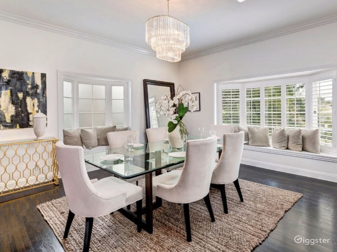 Formal dining room with bay window overlooking charming Cheviot Hills street.