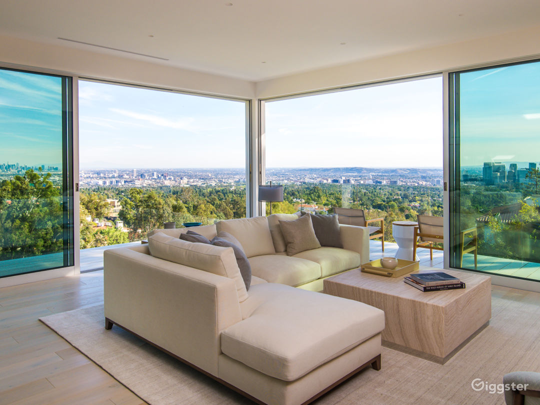 Fully Furnished living room with 270 degrees views of DTLA, Century City and Pacific Ocean.