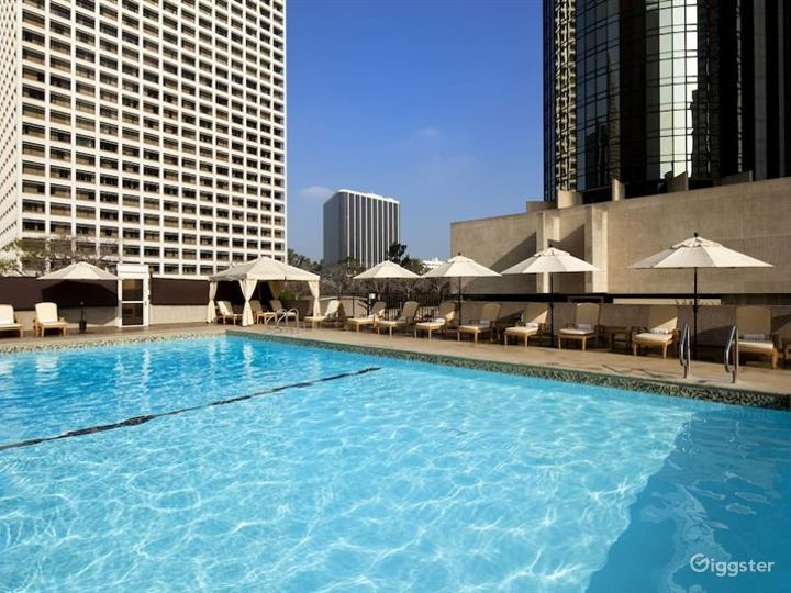 Expansive rooftop pool deck with views of LA Photo 2