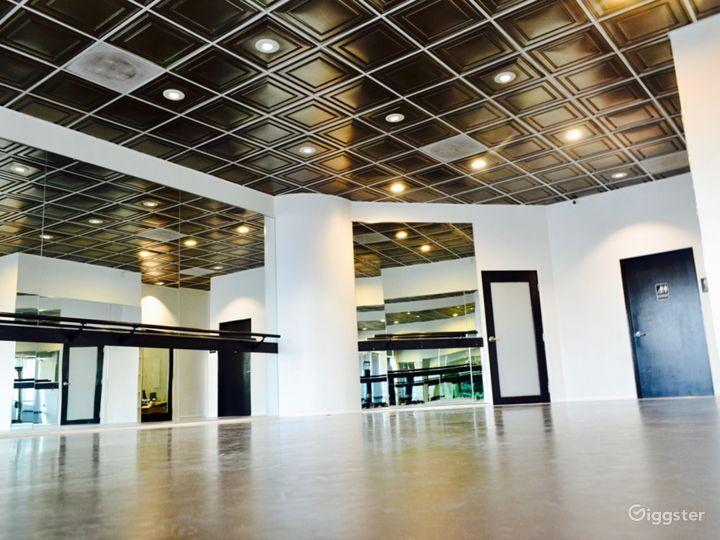 Dance studio ceiling tiles with adjustable pot lighting