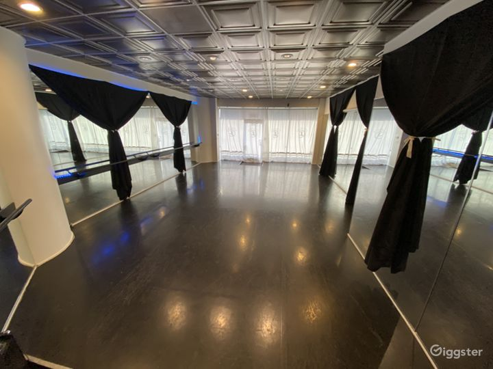 Dance studio with night vibes curtains to block out mirrors for performance or black box theater space