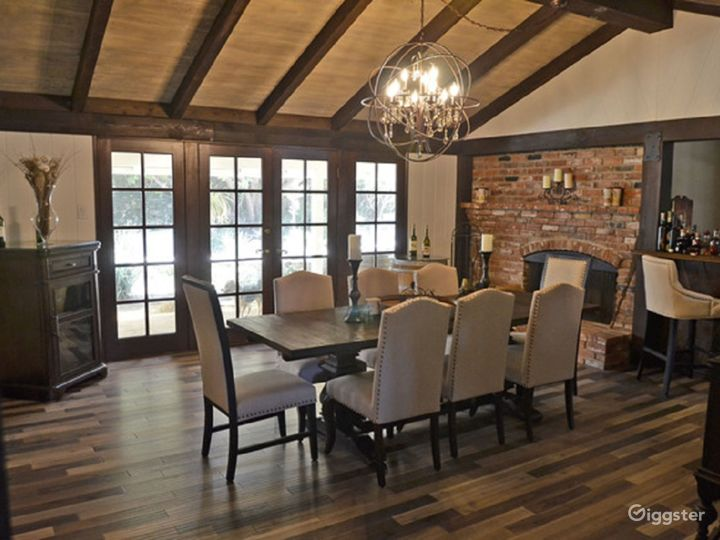 Dining Room with brick working fireplace, bar and french doors leading to charming patio area