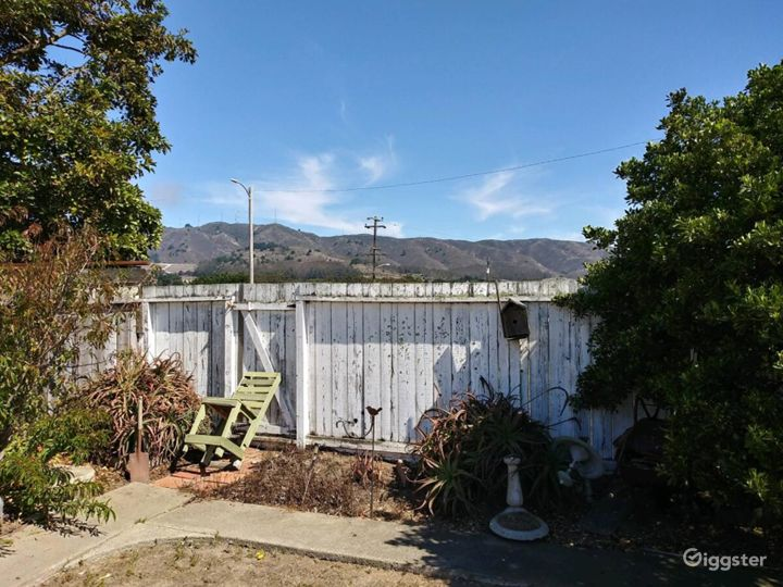 This is the back fence with the mountain view which on the other side is a flat easement, where there is a city park about 100 feet from the back fence