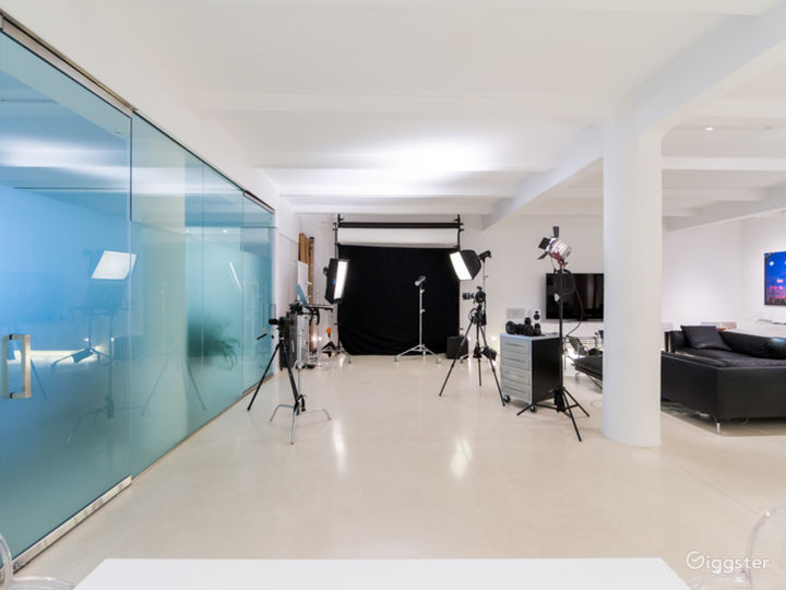 Photo Studio space with private glassed in conference room on the left.