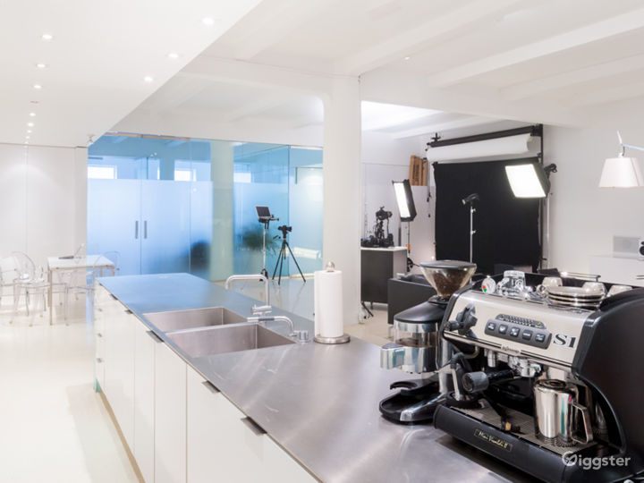 View of the amazing custom single piece integrated stainless steel countertop and sinks.  La Spaziale espresso machine.  Vola faucets.