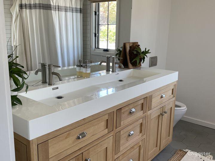 Unique double vanity in master bath, handmade ceramic tile floor, Soaking tub