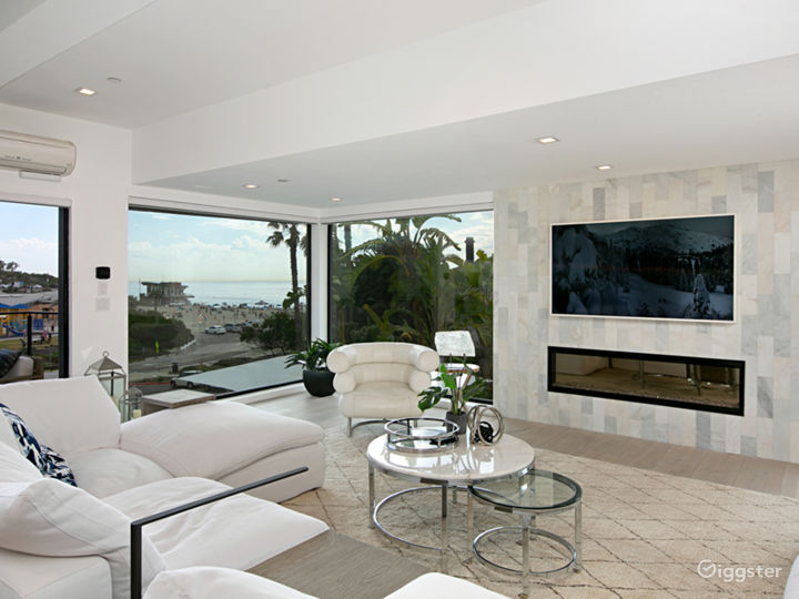 modern living room with fireplace and beach/ocean view