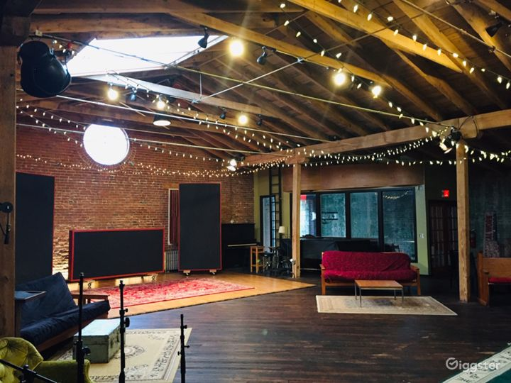 Rustic Studio with Natural Wood and Brick for Film Photo 4