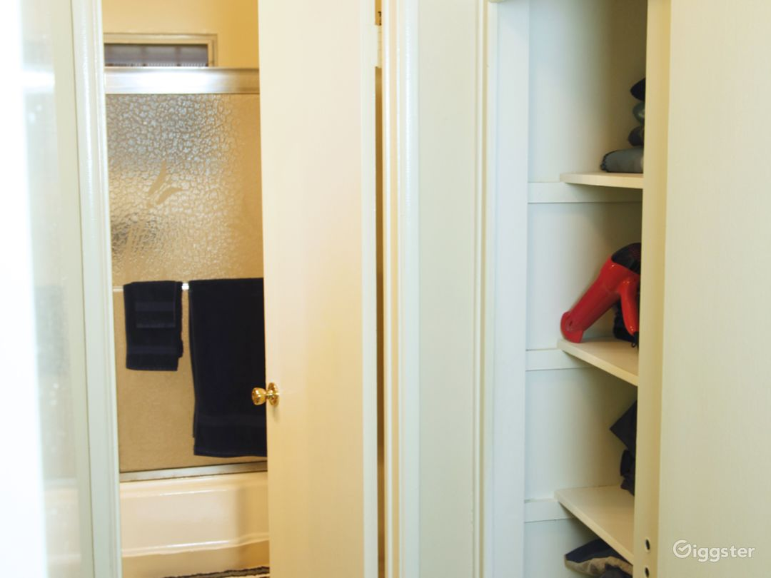 Two closets on both sides in hallway.  Entry way to bathroom.