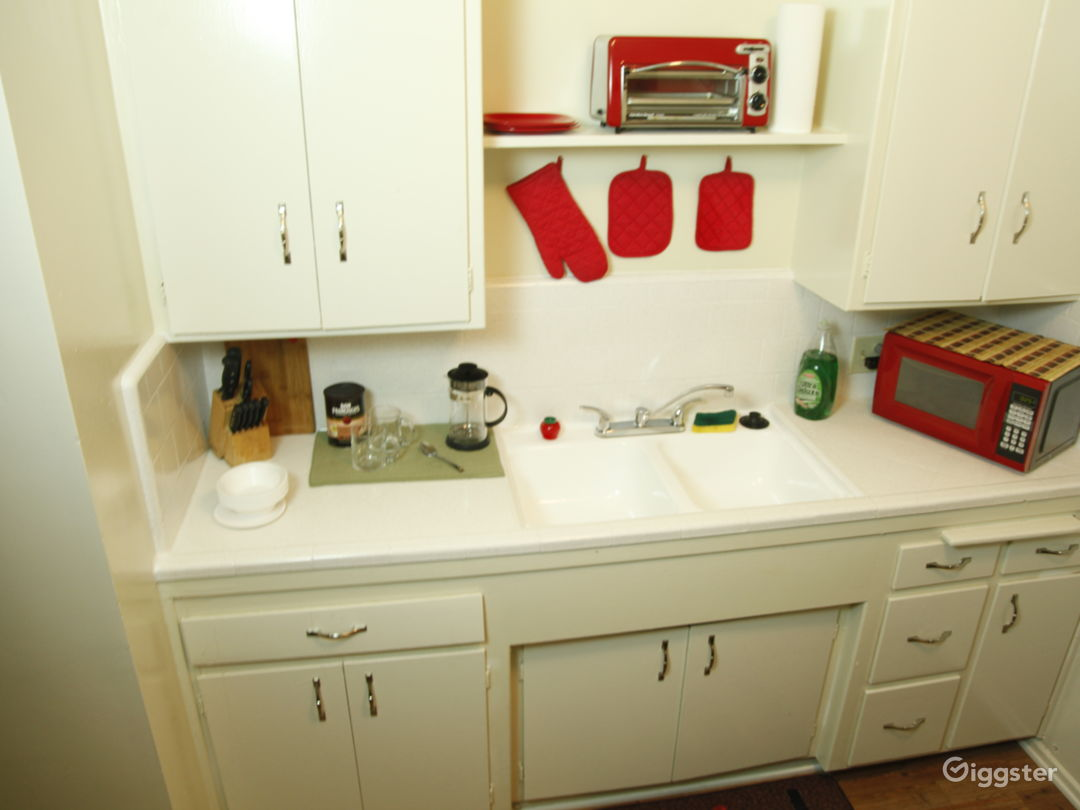 Country country with with white gas stove and fridge in great condition.